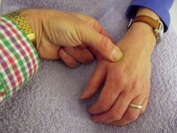 Teaching acupressure to assist in labour.